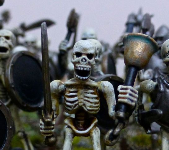 Skeleton musician with bell