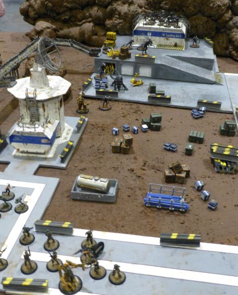 Colonials fighting Aliens in an outpost