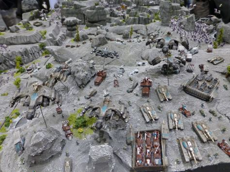 A large battle diorama for Dropzone Commander set in a grey ash wasteland