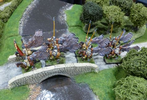 Winged lancers crossing a bridge