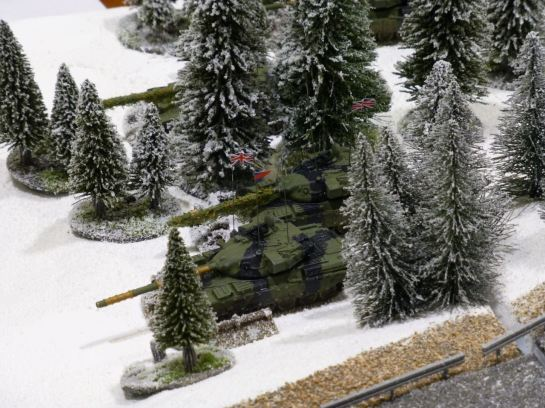 Battle tanks in a winter forest