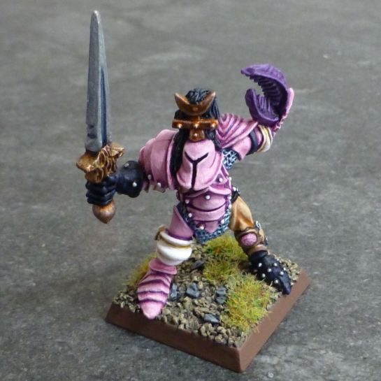 Front of Chaos Warrior of Slaanesh in pink armour with sword