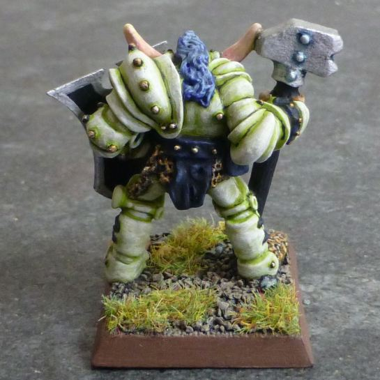 Back of Chaos Warrior of Slaanesh in light green armour with maul and shield