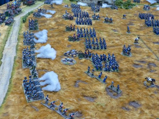 Cannons firing at advancing infantry