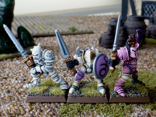 Front view of three Slaaneshi Warriors of Chaos with various armaments