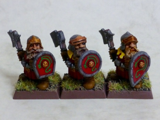 Three dwarf troopers of the Dragon Company with axes and shields