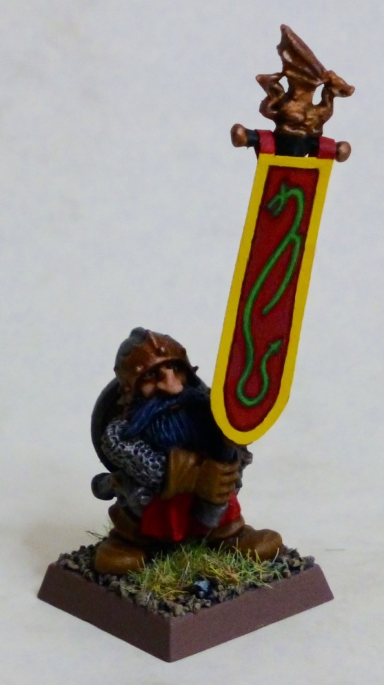 Dwarf standard bearer carrying the banner with a green dragon on red field