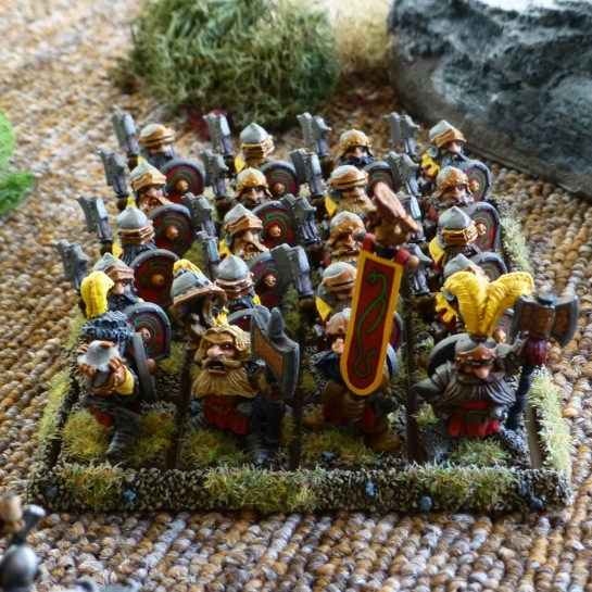 A twenty strong regiment of Dwarfs from Prince Ulther's Dragon Company in red and yellow livery