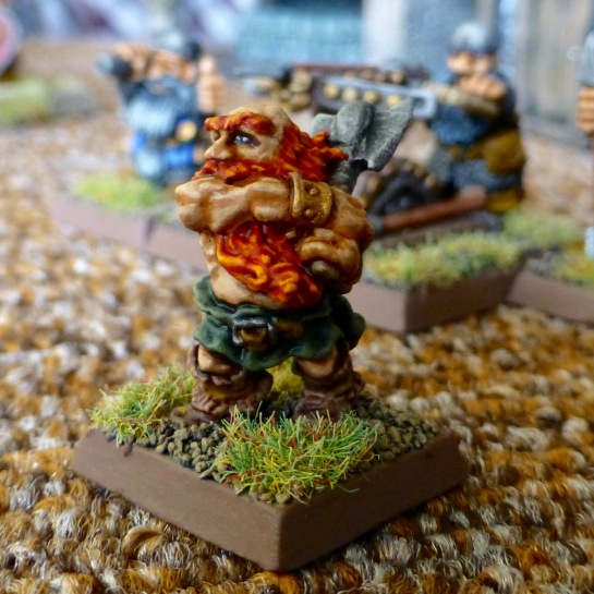 Orange haired Dwarf swinging an axe with both hands