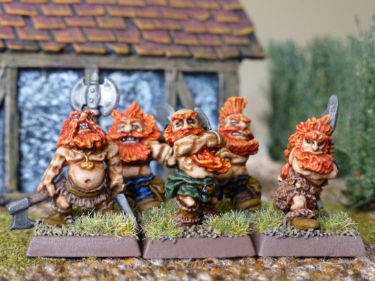Unit of five orange haired, bare chested Dwarfs