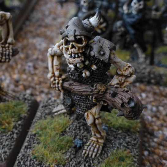 Skeleton ogre with horned helmet and large club