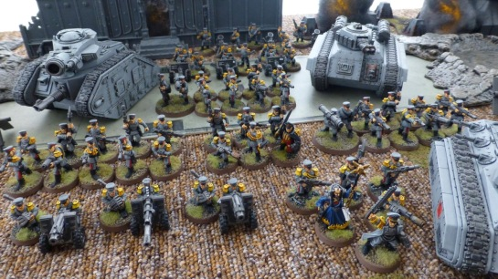 Infantry and tanks of the Mordian Iron Guard in a ruined cityscape
