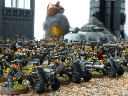 Mordian Iron Guard heavy bolters and autocannon in front of advancing infantry