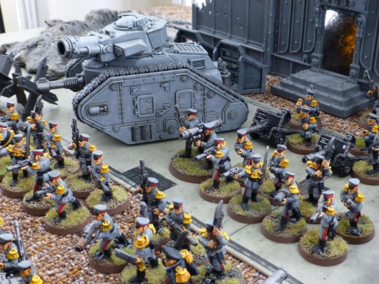 Leman Russ Demolisher tank and infantry of the Mordian Iron Guard