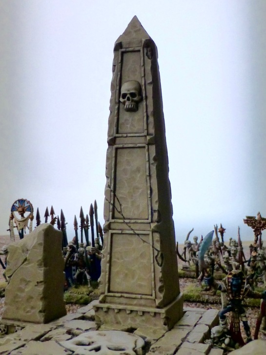 Sandstone obelisk adorned with a skull