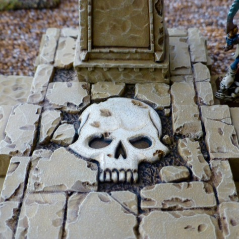 Sandstone floor of a small temple inlaid with a skull design