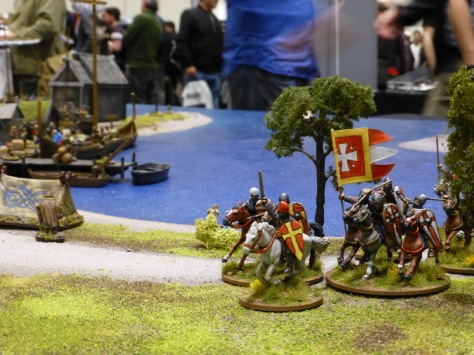 Galloping cavalry emerging from between trees