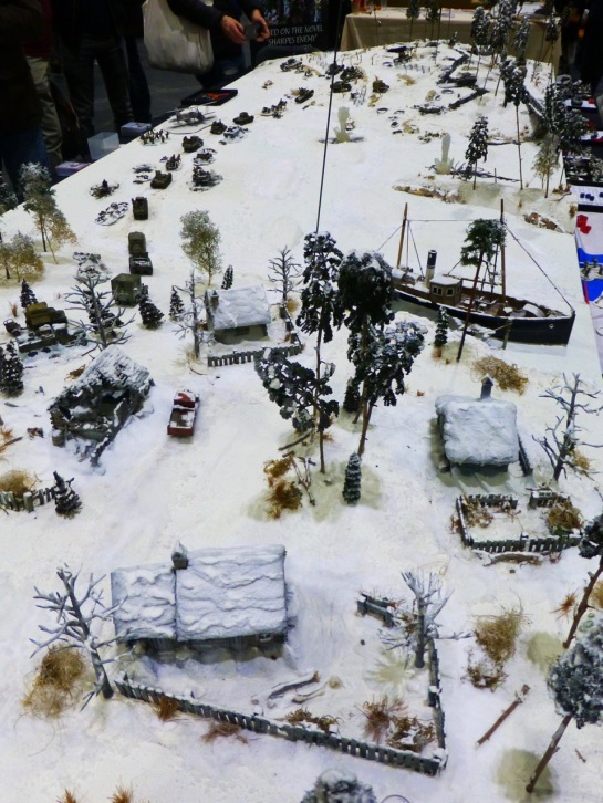 Large World War 2 themed wargaming table with winter scenery in 28mm scale
