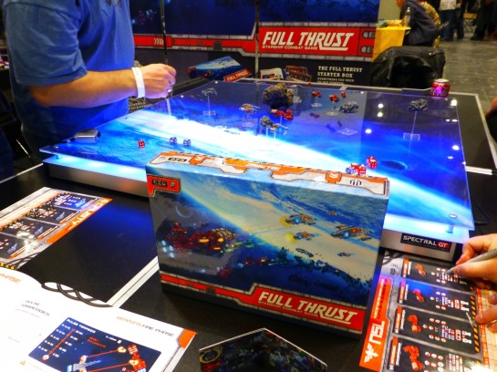 Game sheets, a box set and a gaming table with space ship scale models