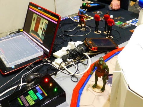 Star Trek action figures, a laptop, cables and other electronic gadgets