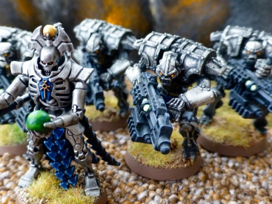 A closer view of the leader of the robotic warriors and his troopers carrying bulky black guns