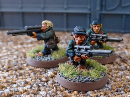 Another group of three Halfling models with rifles wearing green uniform jackets