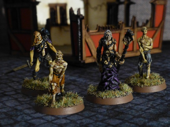 A necromancer flanked by three zombies