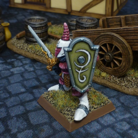 Chaos Warrior in white and pink armour with a green shield and the white symbol of Slaanesh