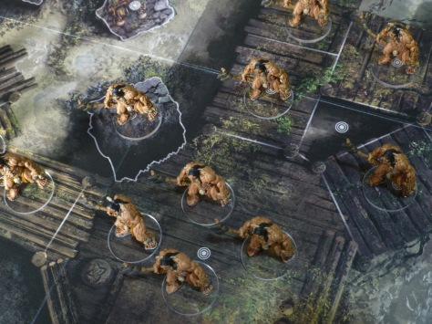 View from above onto an illustrated game board with Pict figures on transparent bases