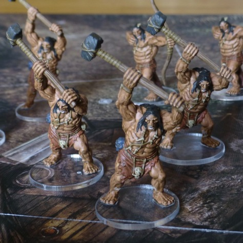 Warriors in loin cloths swinging double handed hammers overhead