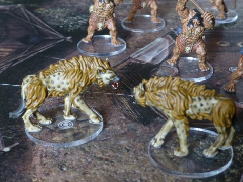 Miniatures of hyenas and Pictish warriors for the Conan board game