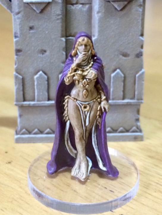 Lady with gold jewellery and a purple cape
