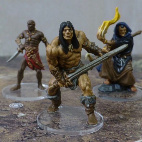 Figure of a muscle packed barbarian with long black hair, loincloth and big sword