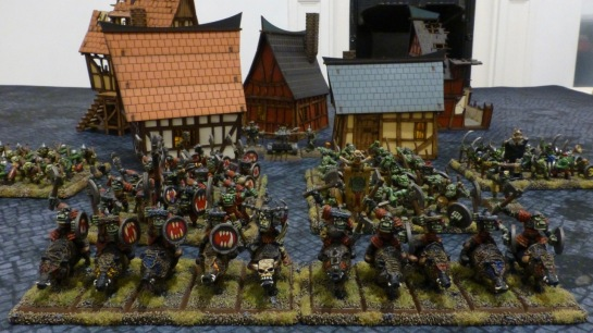 Army of Orcs & Goblins in front of a medieval village
