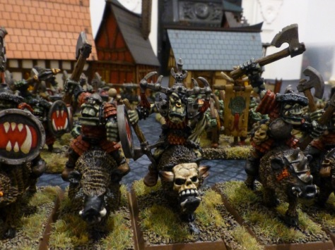 Orc leader on war boar with a horned skull head plate