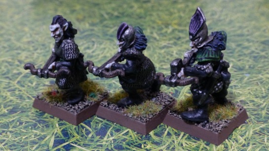 Three figures of Dark Elves carrying crossbows