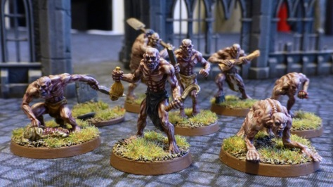 A pack of seven ghouls in a ruined city scape