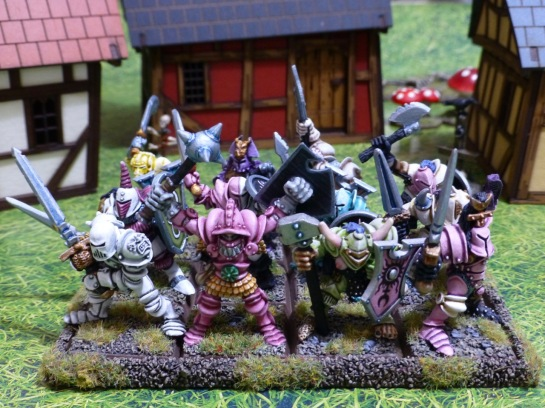 Regiment of twelve Chaos Warriors in bright pastel shaded armour