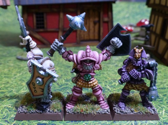 Three warriors in pastel shade heavy plate armour