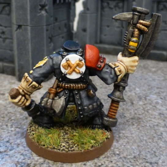 Back view of Ork with crossed golden axes on white backplate