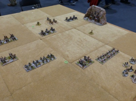 Archers and chariots clashing on a desert table