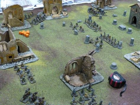 Medieval troops skirmishing amongst ruined town houses