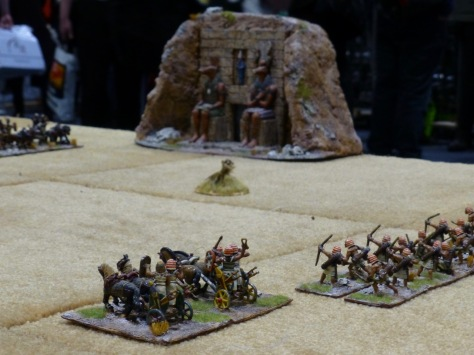 Egyptian chariots and archers in front of tomb complex