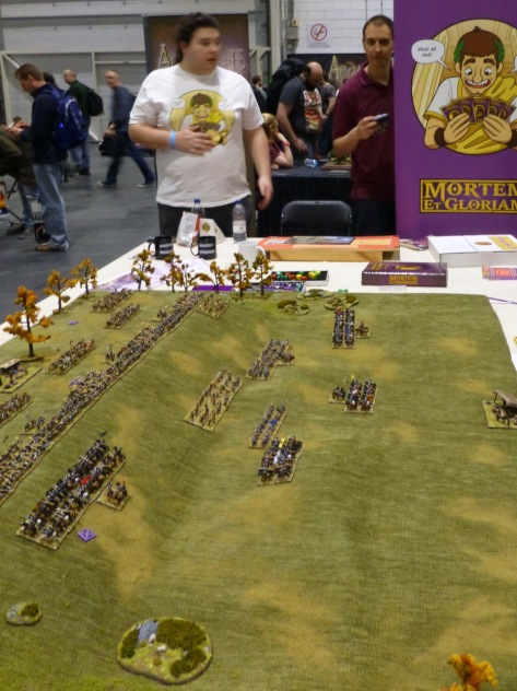 Wargames table with ranks of small scale miniatures
