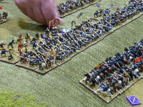 Close up of cavalry riding uphill against a line of spearman