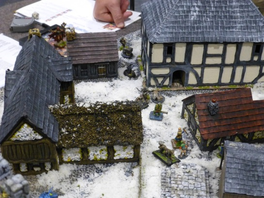 Medieval city streets under snow with adventurers and undead