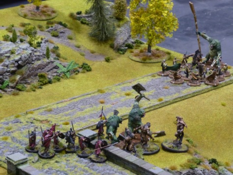 Troll monsters fighting against spear armed humans