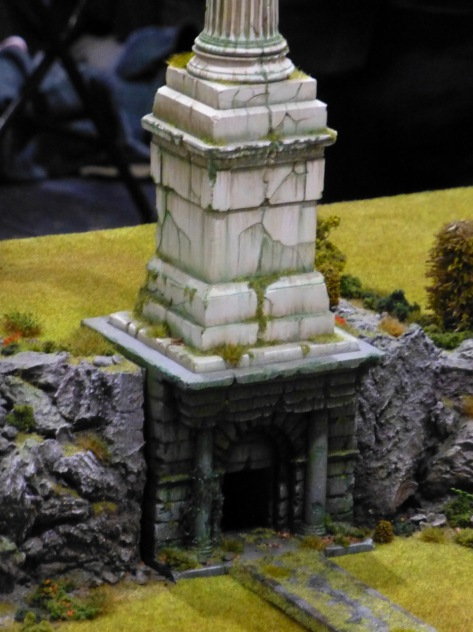 Dark stone portal and white marble weathered pillar