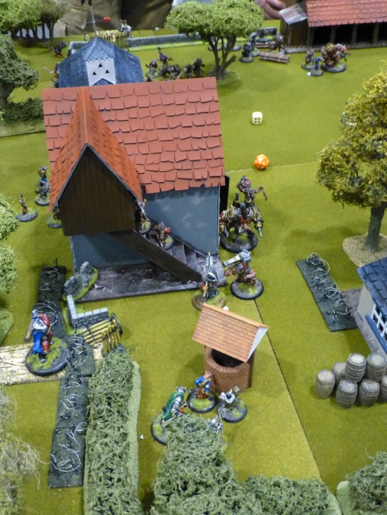 Farmland and buildings with skirmishing miniatures