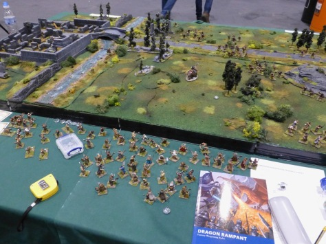 Large wargames table with grassland, river and ruins